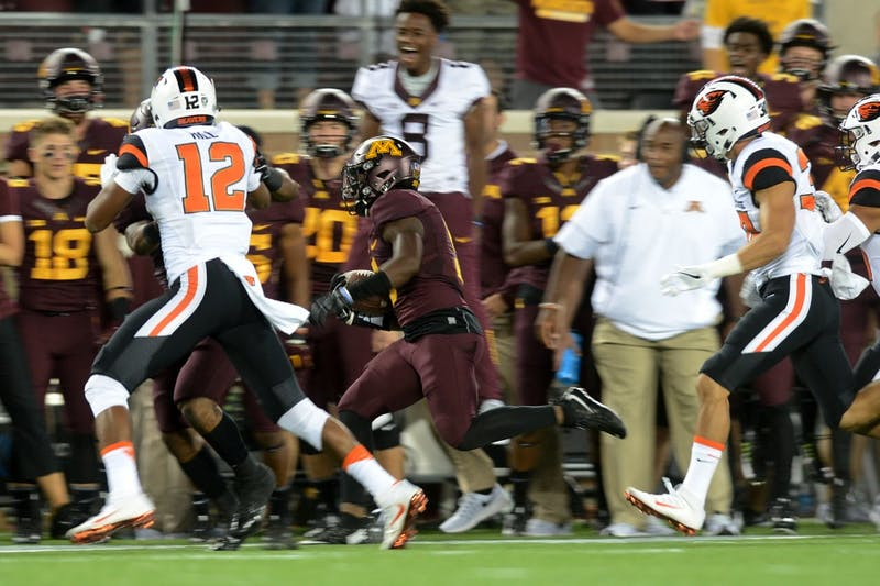 Defensive back Jalen Myrick makes a break with the ball during the Gophers' game against the Oregon State Beavers on Thursday, Sept. 1, 2016 at TCF Bank Stadium.