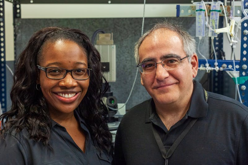 Researchers Michelle Corkrum, left, and Alfonso Araque, right, pose for a portrait in the Winston and Maxine Wallin Medical Biosciences Building on Wednesday, Jan. 29. The scientists helped lead a recently published study demonstrating a potential new method for conducting drug addiction treatment.