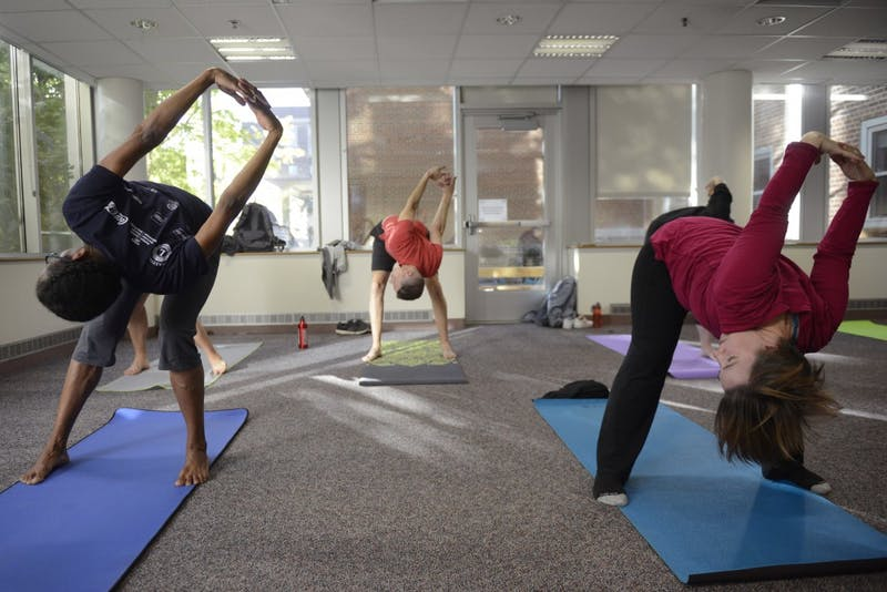Students and staff participate in a yoga class offered by Boynton Health Monday.