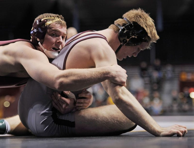 Minnesota's Logan Storley (174) wrestles Virginia Tech's Austin Gabel on Friday, Feb. 22, 2013, at Williams Arena.
