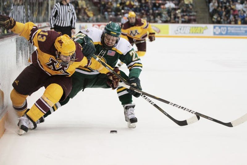 Gophers junior forward Nico Sacchetti and Anchorage sophomore defender Drew Darwitz fight for the puck on Friday March 11 at Mariucci Arena.