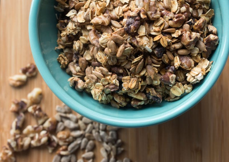 Savory granola with oats, sunflower seeds, walnuts and spices is a delicious topping for salads and soups.