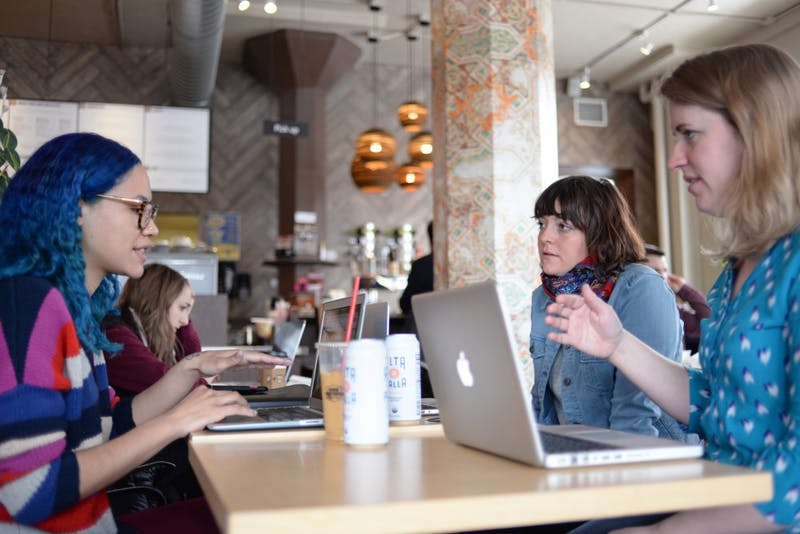 Elexis Trinity Williams, left, Nora Radtke and Alyce Eaton meet at Dunn Brothers Coffee shop to discuss research findings on Sunday, April 8. Researchers from the University are partnering with Human Rights Watch to find how people come to their views on human rights and how those opinions can be changed.