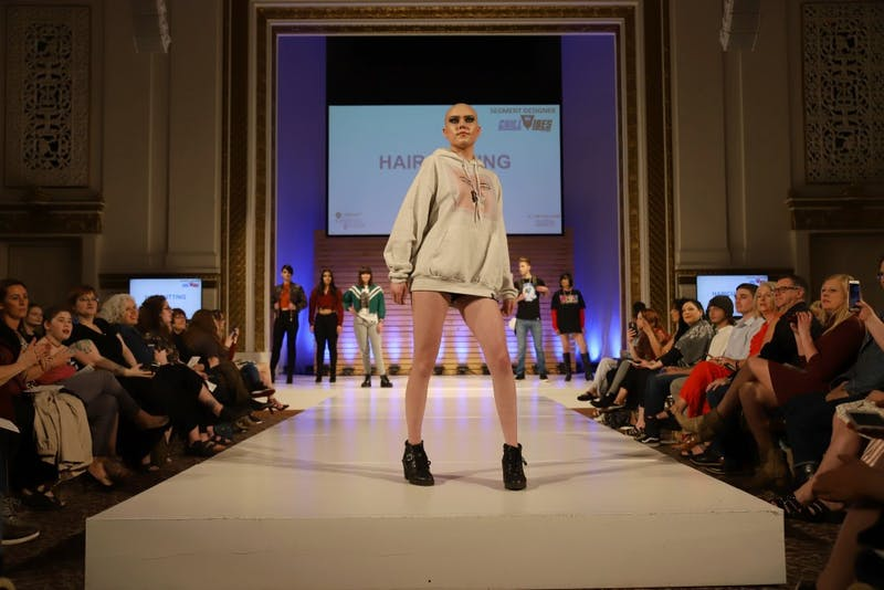 A model walks on the runway for the 'Catwalks for Water' Aveda fashion show on Saturday, April 20 in Minneapolis.