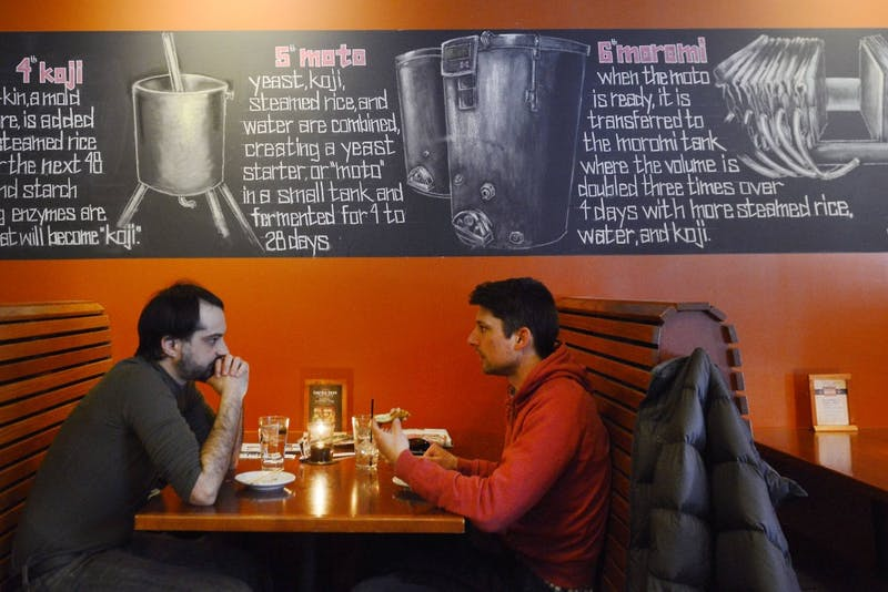 Pete and Chris Jones eat at moto-i Ramen and Sake House in Uptown on Wednesday. Moto-i is one of many restaurants participating in Minneapolis-St. Paul Magazine's Restaurant Week.