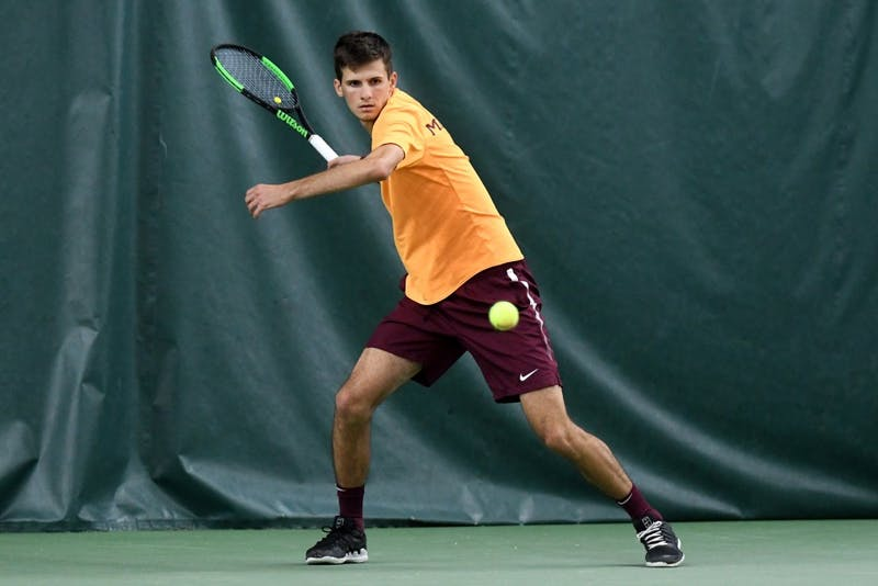 Senior Marino Alpeza competes in his singles match on Friday, March 22 at the Baseline Tennis Center.