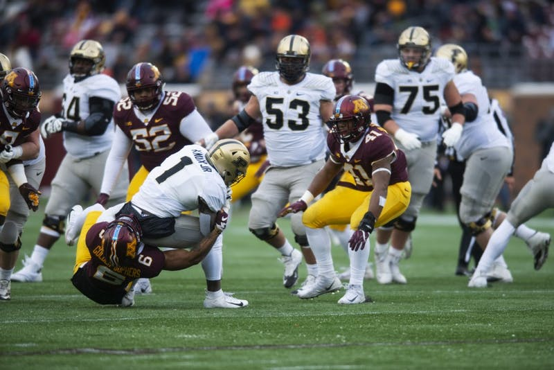 Defensive back Chris Williamson tackles Purdue during the game on Saturday, Nov. 10 at TCF Bank Stadium. The Gophers beat the Boilermakers 41-10.