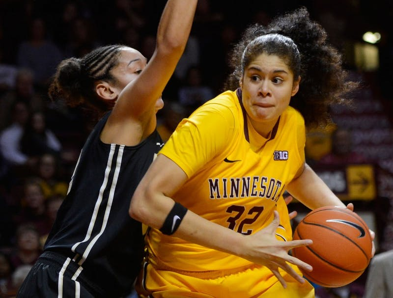 Gophers center Amanda Zahui B. runs the ball past Purdue at Williams Arena on Thursday. Purdue beat Minnesota by two points in overtime 90-88.