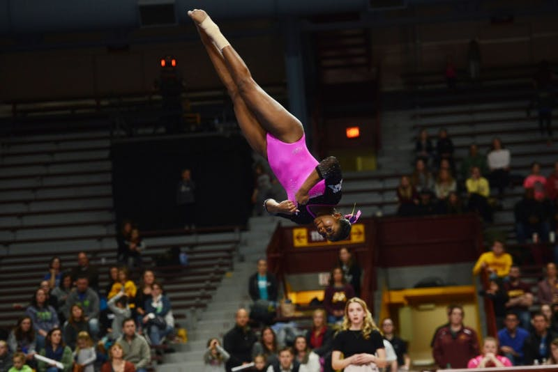 Junior Paige Williams performs her floor routine at Maturi Pavilion on Friday, Feb 15.