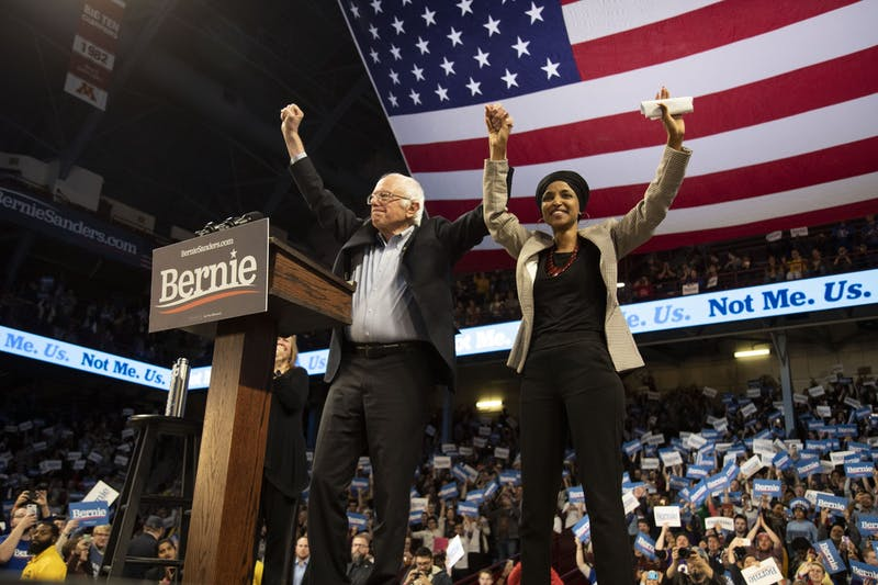 Sen. Bernie Sanders and Rep. Ilhan Omar, D-Minn., face the crowd together during a rally held at Williams Arena on Sunday, Nov. 3.