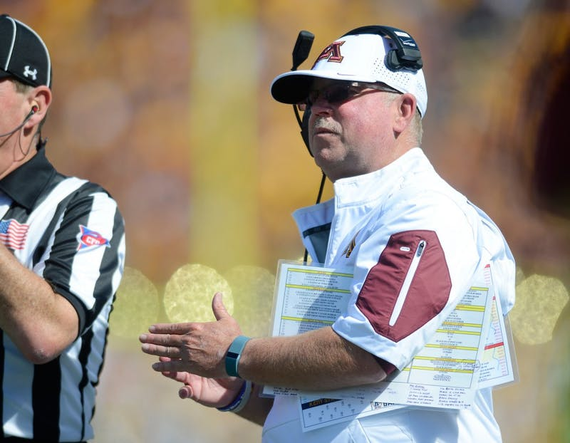 Head coach Jerry Kill looks on from the sidelines at TCF Bank Stadium on Saturday where the Gophers defeated Kent State 10-7.