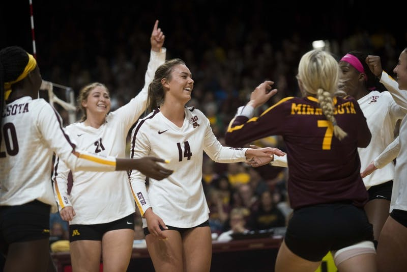 Setter Kylie Miller celebrates a scored point with her team at the Maturi Pavilion on Saturday, Sept. 7. The Gophers defeated Florida 3 sets to 0 for their home opener.