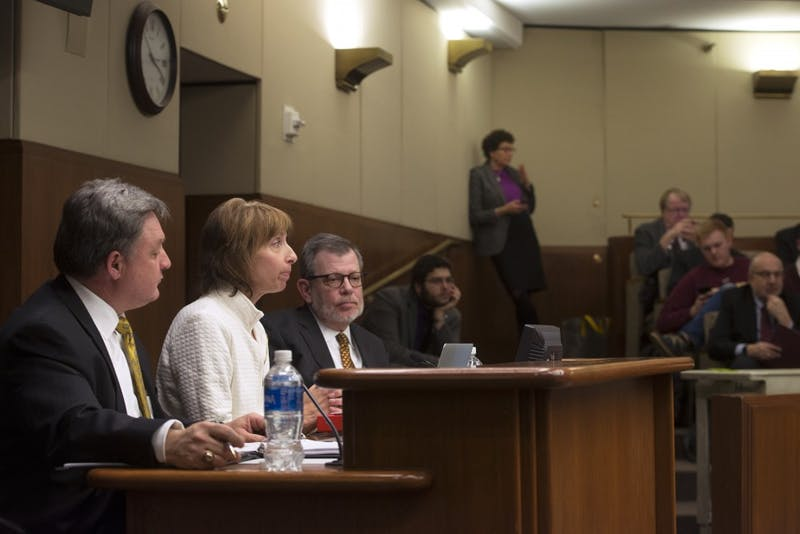 Brian Burnett, Julie Tonneson and University President Eric Kaler present to the House of Representitives' higher education committee about the University's impact on Minnesota at the State Office Building on Tuesday, Jan. 24, 2017.