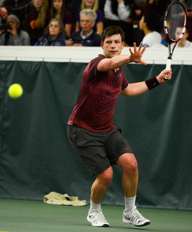 Senior Leandro Toldeo volleys the ball at the Baseline Tennis Center on March 6 against Washington.