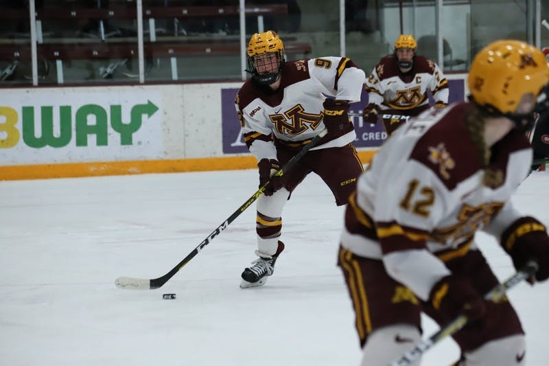 Gophers Forward Taylor Heise lines up a pass at Ridder Arena on Friday, Feb. 28. The Gophers scored two power-play goals on the way to a 4-2 victory over St. Cloud State.