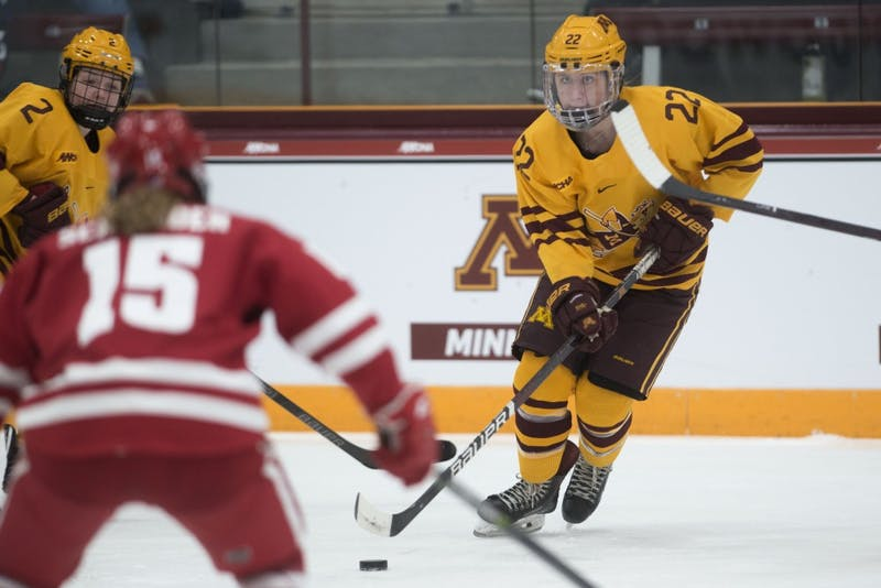 Forward Abigail Boreen keeps and eye on Wisconsin's Caitlin Schneider on Sunday, March 10 at Ridder Arena.