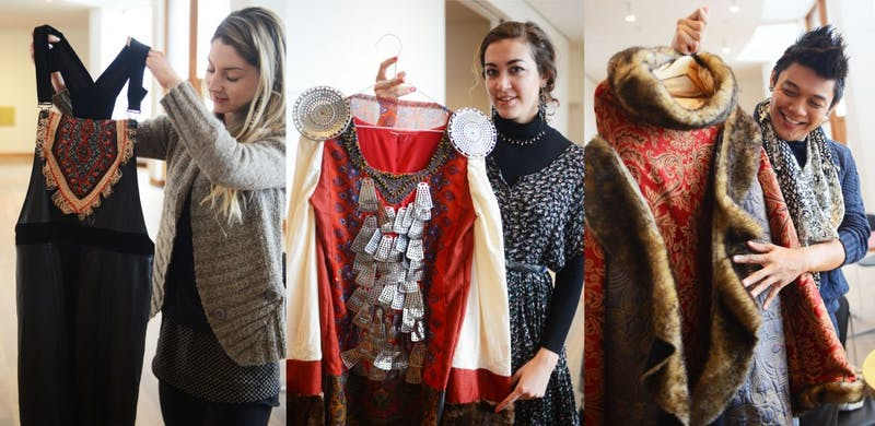 """Apparel designer students Holly Welwood, Catherine Menzel and Lee Tran give a sneak peak of their designs for the WAM Collective's """"Elements"""" fashion show."""
