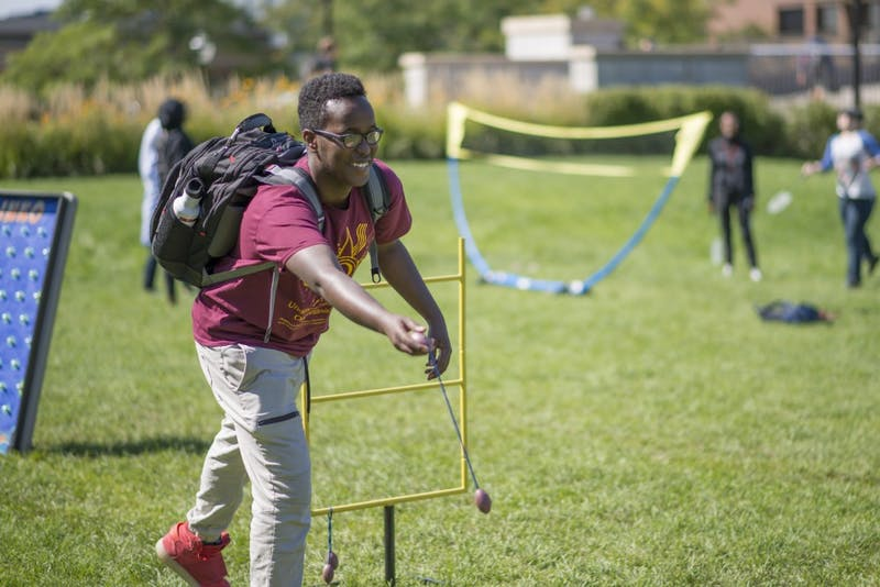Freshman Khalid Abdalla plays ladder toss at the Eid celebration organized by the Muslim Student Association and the Al-Madinah Cultural Center on Thursday, Sept. 6 in front of Coffman Memorial Union.