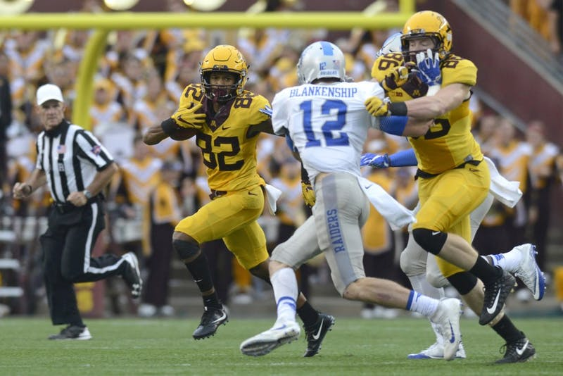 Wide receiver Demetrius Douglas runs with the ball against Middle Tennessee on Sept. 16 at TCF Bank Stadium.