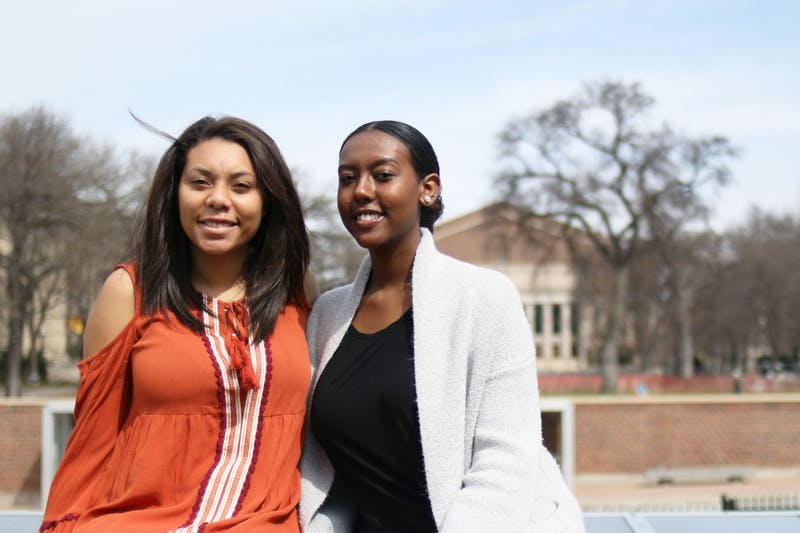 Kaylin Fernandez and Nassisse Geleta pose for a portrait on Saturday, April 8, 2017. The two are starting a living learning community at the University for first and second-year black women at the University.