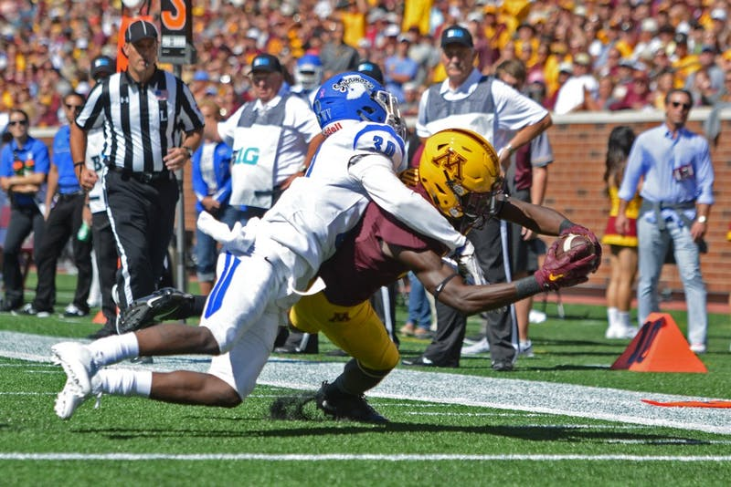 Freshman wide receiver Tyler Johnson completes a pass for a touchdown against Indiana State on Saturday, Sept. 10, 2016 at TCF Bank Stadium.