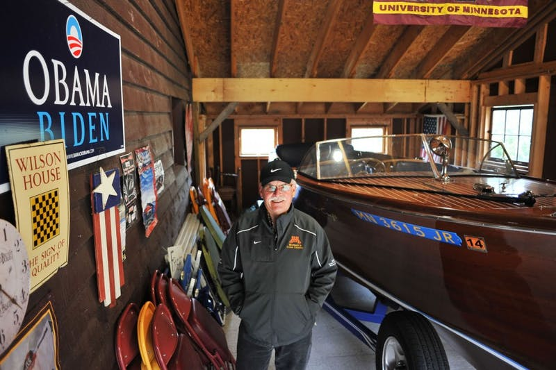 Head women's cross country coach Gary Wilson stands in the addition to his barn, which he built with his sons to house his 1950 Chris Craft classic wooden boat, on Friday at his home in Stillwater, Minn. Wilson will retire in June after 28 years coaching the Gophers.