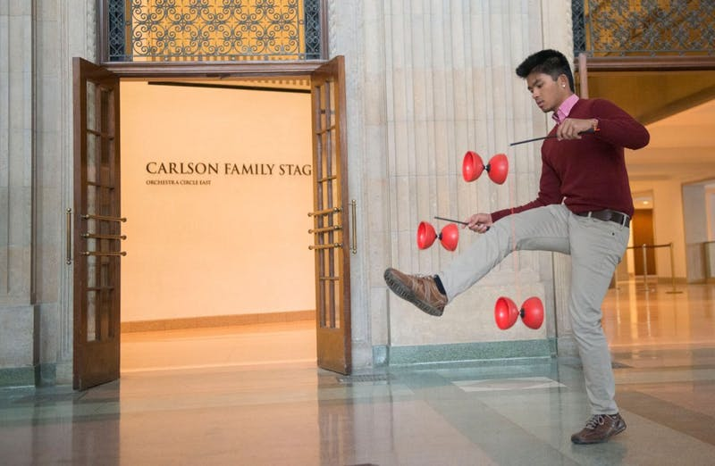Sophomore and vice-president of the University's Juggling Club Yang Yang Sim practices the Diabolo Wednesday afternoon at Northrop.