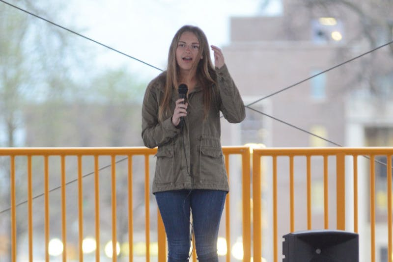 Sexual assault advocate Abby Honold speaks to a crowd on East Bank on April 18.