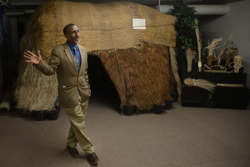 Osman Mohamed Ali stands in front of a traditional nomad somali hut and homestead at the Somali Museum of Minnesota on Friday, April 14, 2017 in Minneapolis.