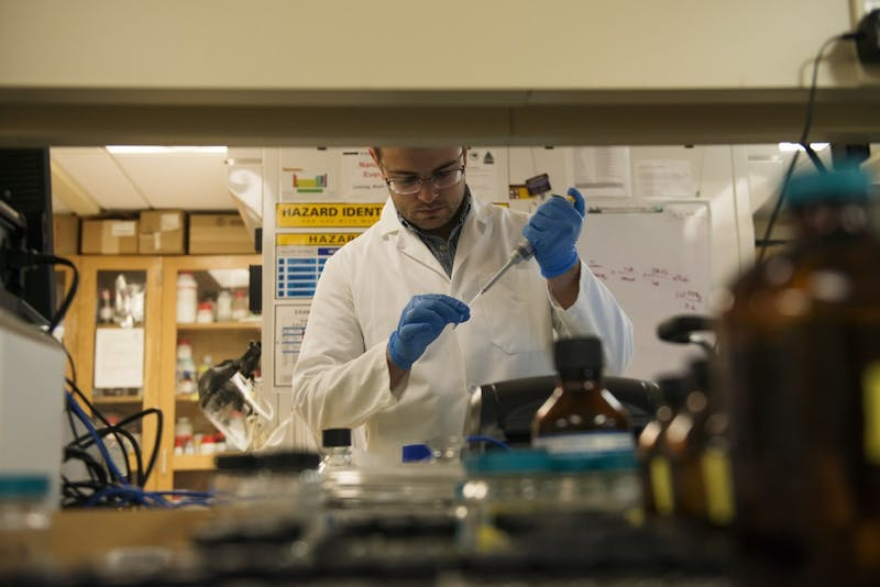 Graduate research assistant John Brockgreitens, who is working on a test that finds bacteria in food, works in a lab on the Saint Paul Campus on Tuesday, October 2. The research was created in response to recent food borne illness outbreaks in the United States.