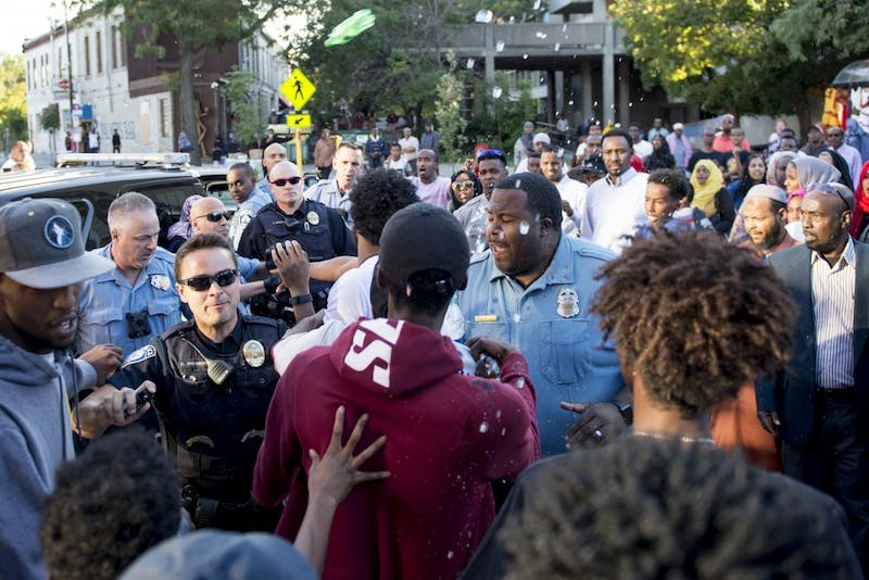 Officers prepare to spray the crowd when individuals started throwing plastic bottles and liquid on Saturday, Sept. 10, 2016 in Cedar Riverside neighborhood.