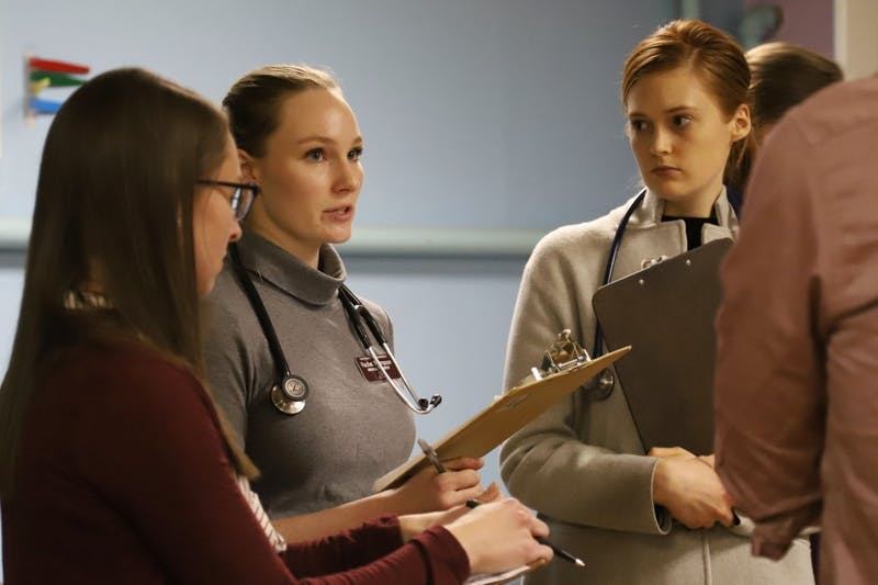 Rachel Thompson and a group of medical students assess the diagnosis for a patient at the Phillips Neighborhood Clinic in Minneapolis on Monday, April 15. The free clinic, which is open from 6 p.m. to 9 p.m. on Mondays and Thursdays, is run by University of Minnesota professional students.