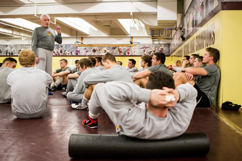 Gophers wrestling head coach J Robinson addresses the team for announcements before their practice on Jan. 20.