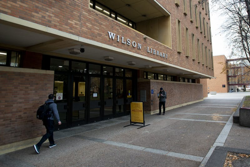 Students walk past Wilson Library on West Bank on Wednesday Nov. 13.