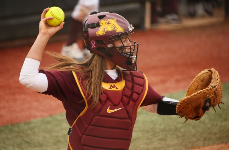 Minnesota catcher Taylor LeMay  looks to throw the ball at the game against Oklahoma State University on Friday, March 7, 2014.