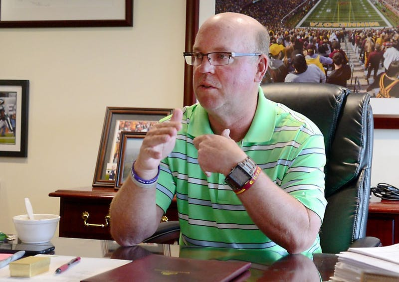 Head Coach Jerry Kill discusses his past four coaching years in his office on Monday.