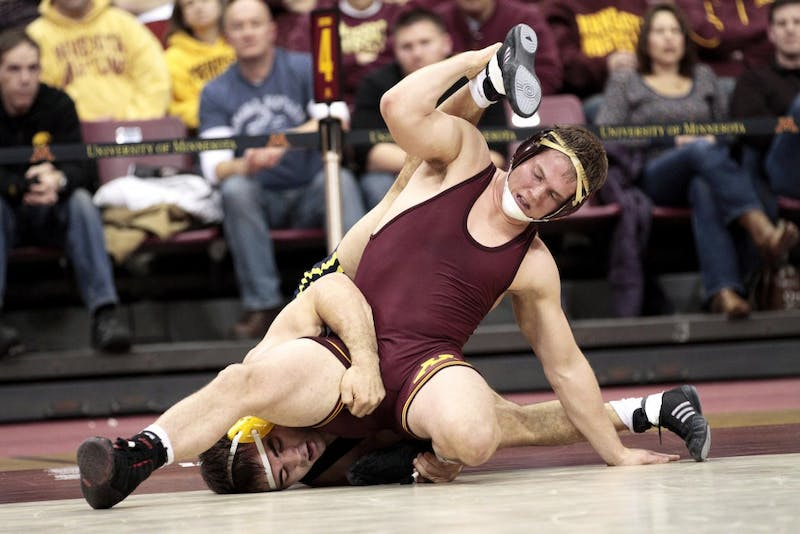 Freshman Logan Storley won the match in overtime against a Michigan wrestler during Friday's competition in the Sports Pavilion.