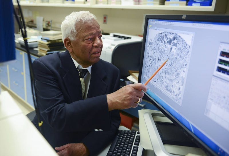 Adjunct professor Akhouri Sinha views a picture of human cells at the Minneapolis Veterans Affairs Medical Center on Monday. Sinha volunteers five days a week doing research on prostate cancer at the VA Medical Center.
