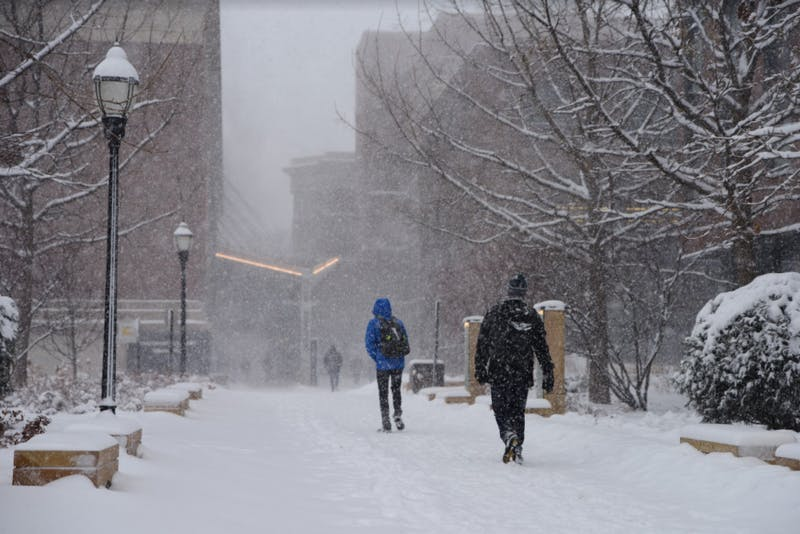 UMN students trudged through the snow to get to classes Monday, Jan. 22 with the metro area facing a snow storm that's expected to result in up to 10 inches.