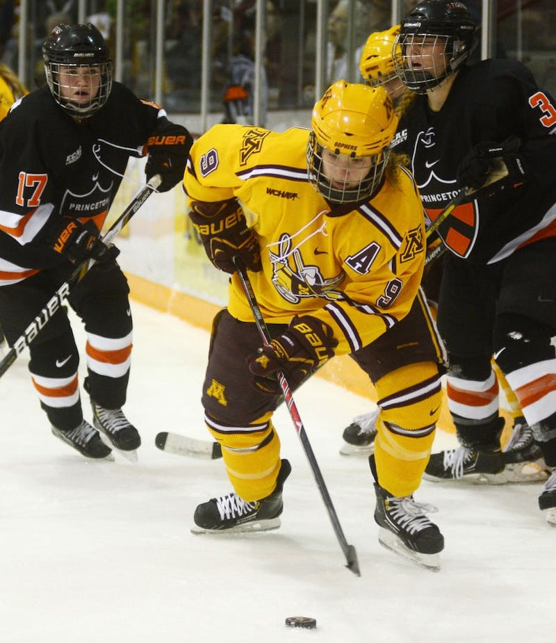 Gophers forward Sarah Davis controls the puck against Princeton on Sunday, Dec. 1, 2013, at Ridder Arena.
