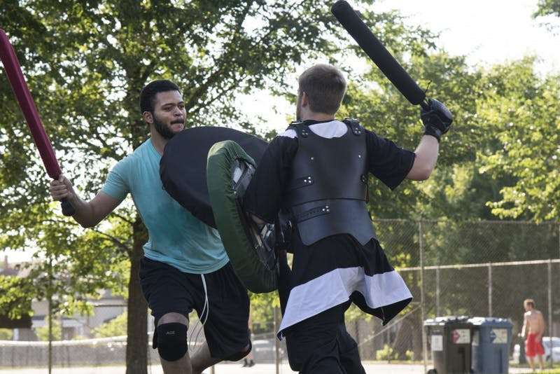 Deforis Nash, left, spars with Chris Polys on Friday at Van Cleve Park.