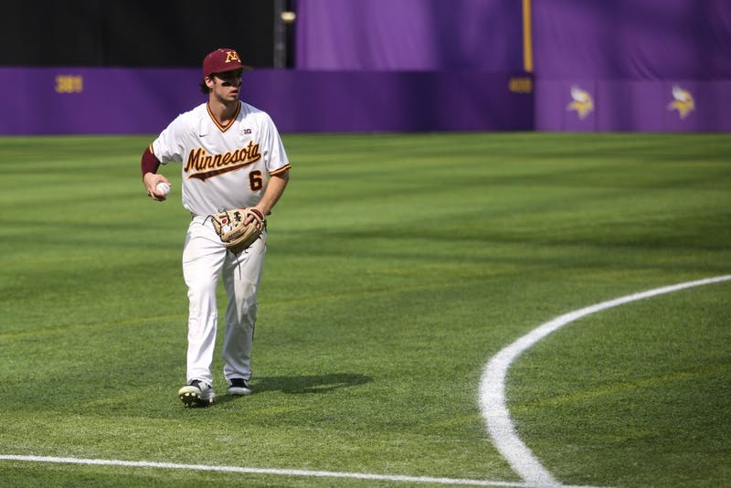 Junior Terrin Vavra returns the ball infield during the game against St. John's University on Saturday, March 31 at U.S. Bank Stadium in Minneapolis. The Gophers won 6-3.