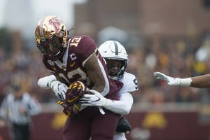 Wide receiver Rashod Bateman fights to hang on to the ball at TCF Bank Stadium on Saturday, Nov. 9. The Gophers bested the Penn State Nittany Lions 31-26 to remain undefeated.