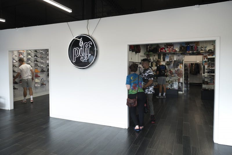 Patrons of Piff, a clothing store on Como Avenue, check out the streetwear items on Saturday, Sept. 1. The store specializes in buying and selling streetwear like Nike, Jordan and Supreme.