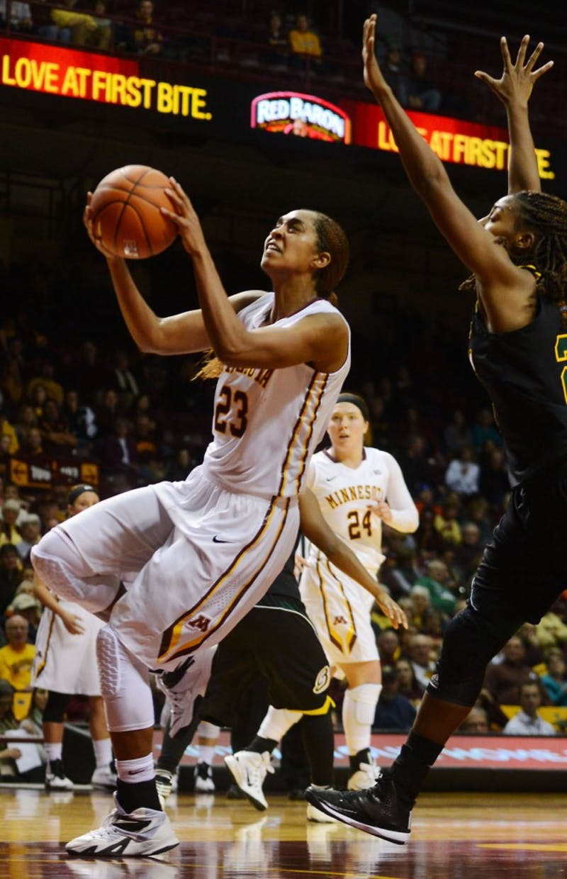 Shae Kelley, forward, jumps to make a basket at the Williams Arena Friday evening. The University of Minnesota women's basketball team defeated Southeastern Louisiana 109-60.