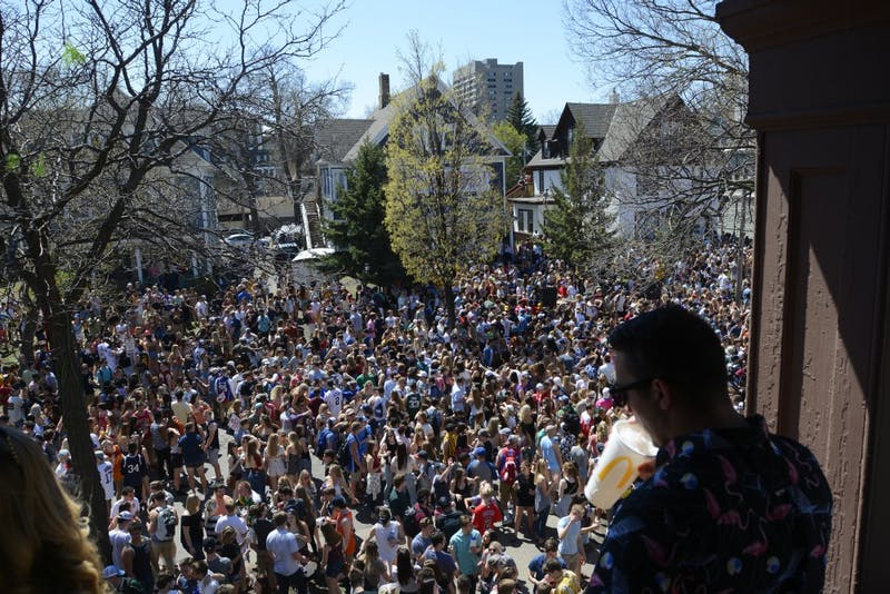 """Kinesiology senior Jared Antilla watches over the crowd from a balcony at the Sssdude-Fest Block Party on Saturday, April 22, 2017. """"I haven't seen anything like this in three years,"""" Antilla said. """"All the homemade parties get broken up."""""""