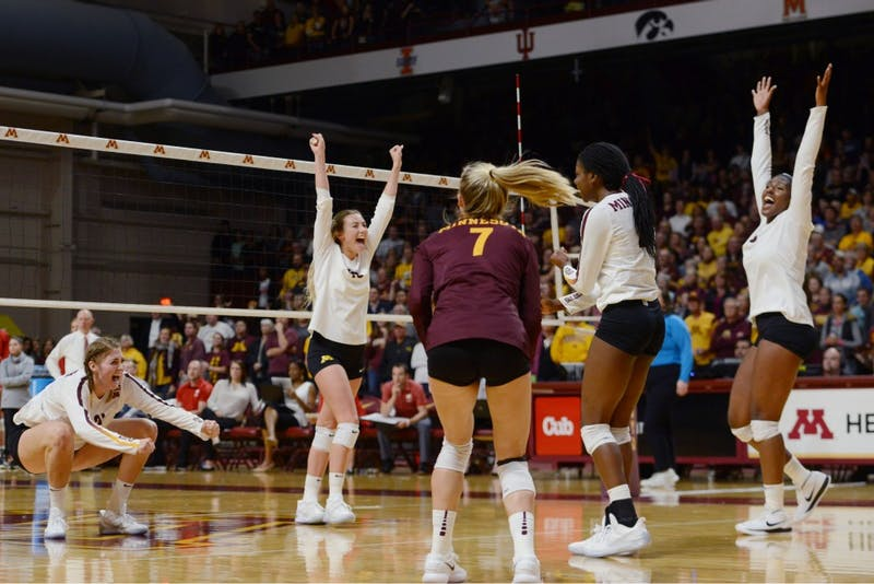 The Gophers celebrate victory on Tuesday, Sept. 26 at Maturi Pavillon.