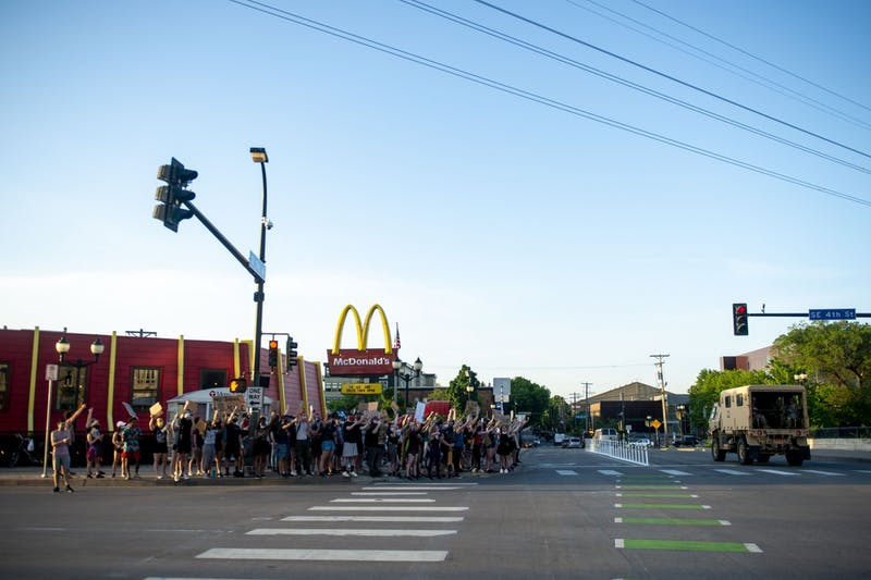 Protesters cheer as SWAT officers leave the intersection of Southeast 4th Street and 15th Avenue Southeast just after 8 p.m. on Monday, June 1. Several people were arrested during a mostly student-led demonstration halting traffic at the intersection.