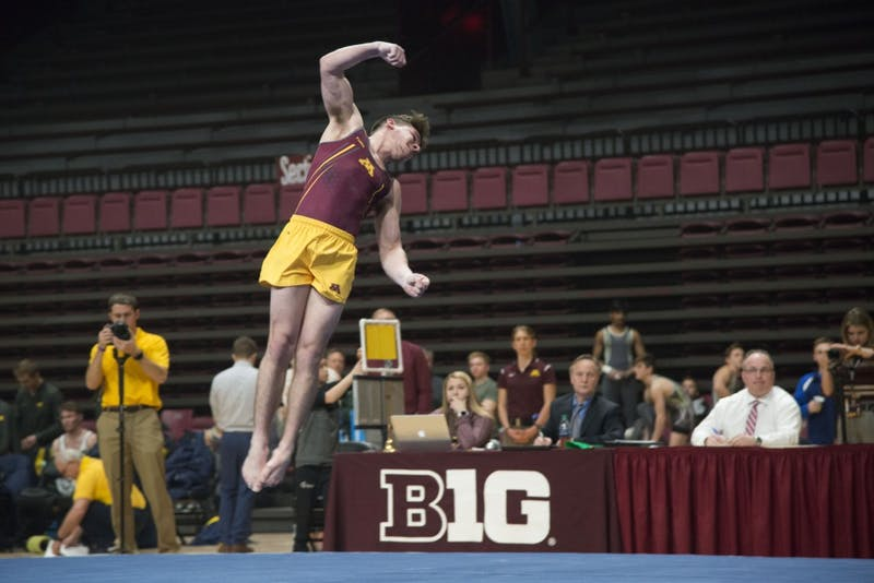 Senior Shaun Herzog competes in the floor exercise at the Maturi Pavilion on Saturday, Jan. 26.
