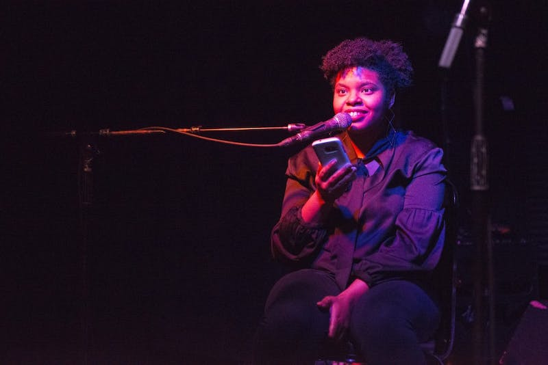 Chavonn Williams Shen reads pieces of her poetry at Honey in Minneapolis on Wednesday, Jan. 17. Shen was one of the featured artists at art collective Err's 36th event.